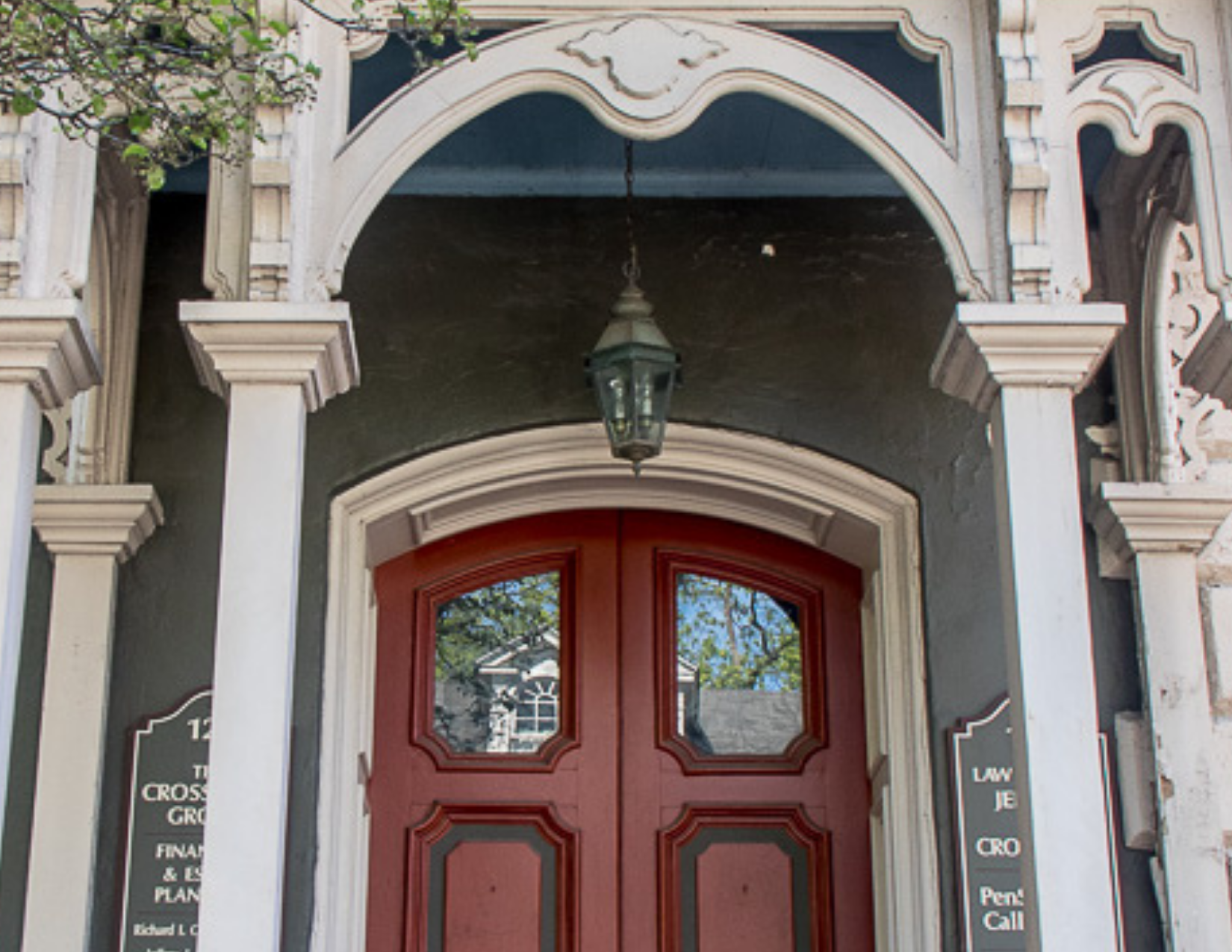 decorative arched entryway with red door